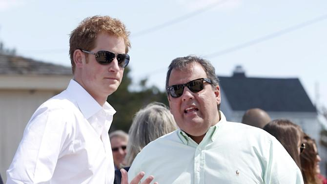 Britain's Prince Harry and N..J. Gov. Chris Christie talk during a tour  in Mantoloking, N.J. on Tuesday, May 14, 2013.  Prince Harry began a tour Tuesday of New Jersey's storm-damaged coastline, inspecting dune construction, walking past destroyed homes and shaking hands with police and other emergency workers.  (AP Photo/The Star-Ledger, Andrew Mills, Pool)