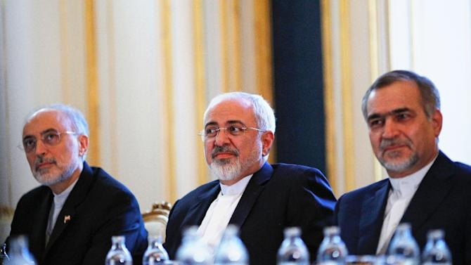 Iran's Foreign Minister Mohammad Javad Zarif (C), head of the Iranian Atomic Energy Organization Ali Akbar Salehi (L) and Hossein Fereydoon, close aide to President Hassan Rouhani, pictured during a meeting in Vienna on July 3, 2015