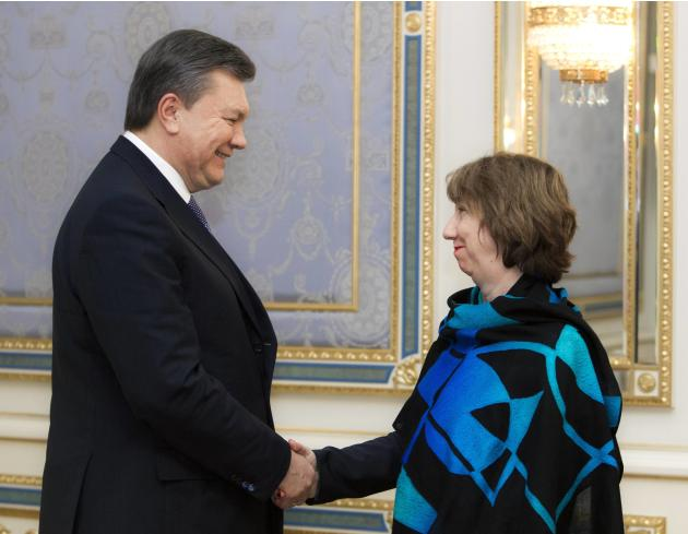 Ukraine's President Yanukovich shakes hands with European Union foreign policy chief Ashton during their meeting in Kiev