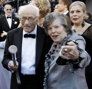 FILE - This Feb. 27, 2011 file photo shows actor Eli Wallach, left, and his wife Anne Jackson at the 83rd Academy Awards in the Hollywood section of Los Angeles. Wallach, the raspy-voiced character actor who starred in dozens of movies and Broadway plays over a remarkable and enduring career died Monday, June 23, 2014 of natural causes. He was 98. (AP Photo/Matt Sayles, File)