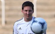 "Argentinian Lionel Messi plays the ball during a public training session. Argentina coach Alejandro Sabello says Messi needs to be left in peace and one should ""talk to him as little as possible"" as the South American giants get set to face Germany in a friendly here on Wednesday"
