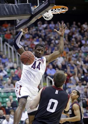 Arizona's Solomon Hill (44) dunks in front of Harvard's Laurent Rivard (0) in the first half during a third-round game in the NCAA men's college basketball tournament in Salt Lake City Saturday, March 23, 2013. (AP Photo/Rick Bowmer)