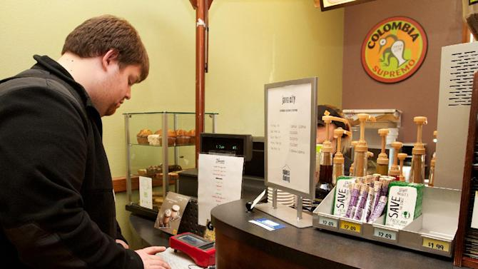 Christopher Jacques, 22, uses his index finger to pay for an Italian soda at a coffee shop at the South Dakota School of Mines and Technology on Friday Feb. 15, 2013. Jacques, an electrical engineering major from Pacific, Wash., is one of about 50 students and four faculty members at the school enrolled in a pilot program that uses Biocryptology -- or one's fingerprint and hemoglobin -- in place of cash or credit cards to pay for items. (AP Photo, Amber Hunt)