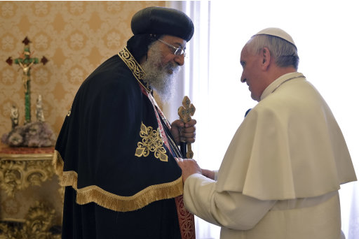 Pope Francis, right, welcomes Coptic Orthodox Church of Egypt Pope Tawadros II for their private audience in the pontiff's library, at the Vatican, Friday, May 10, 2013. The head of the Coptic Orthodox Church of Egypt, Pope Tawadros II, called on Pope Francis on Friday in the first such meeting in 40 years. The occasion was to mark the anniversary of the signing of a declaration for improving ties between the two churches between Pope Paul VI and Tawadros' predecessor, Pope Shenouda III. (AP Photo/Andreas Solaro, pool)
