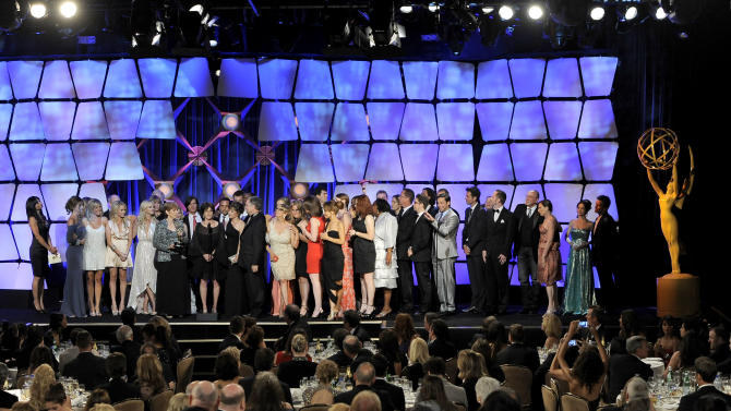 """The cast and crew of """"General Hospital"""" accept the award for drama series onstage at the 39th Annual Daytime Emmy Awards at the Beverly Hilton Hotel on Saturday, June 23, 2012 in Beverly Hills, Calif. (Photo by Chris Pizzello/Invision/AP)"""