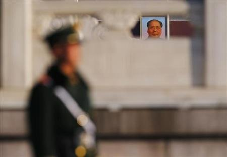 China's Communist Party expels former executive of defense firm