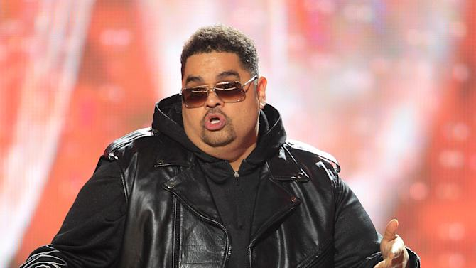 FILE - In this Oct. 1, 2011 photo, rapper Heavy D, also known as Dwight Arrington Myers, performs during the BET Hip Hop Awards in Atlanta.  The culture that in the 1990s lost its brightest stars to gun violence has in recent years seen a series of notable rappers die of drug- and health-related causes. Since 2011, hip-pop pioneer Heavy D, singer and rap chorus specialist Nate Dogg and New York rapper Tim Dog all died of ailments in their 40s. (AP Photo/David Goldman, file)