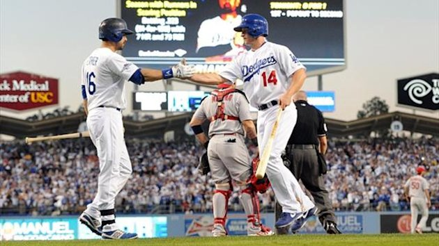 Los Angeles Dodgers second baseman Mark Ellis (14) celebrates with center fielder Andre Ethier (16) after scoring a run in the fourth inning against the St. Louis Cardinals (Reuters)
