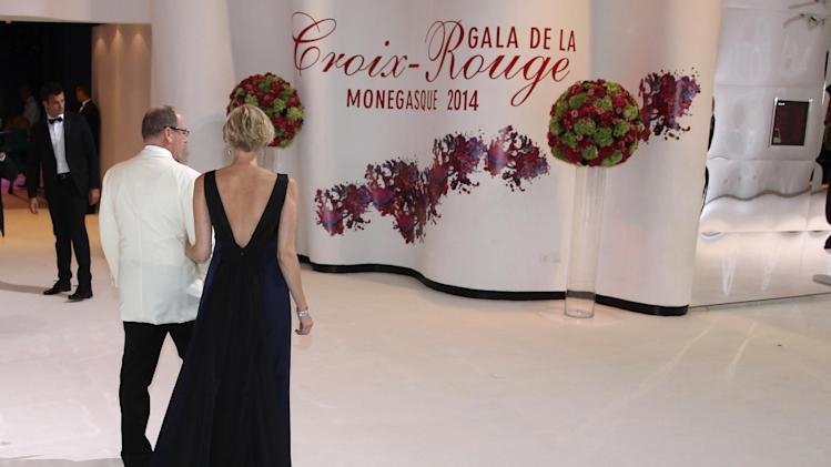 "Prince Albert II of Monaco with his wife Princess Charlene, arrive at the ""Monaco Red Cross Ball"", Friday, Aug. 1, 2014, in Monaco. The Monaco Red Cross Ball is a charity gala evening brings together high society as well as donors from all over the world. (AP Photo/Lionel Cironneau)"
