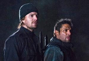 Stephen Amell, Manu Bennett | Photo Credits: Cate Cameron/The CW