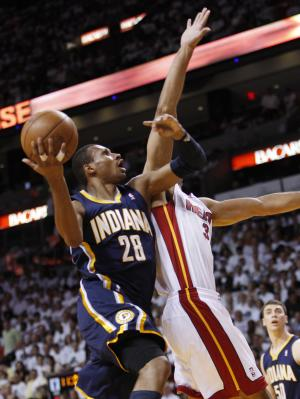 Indiana Pacers guard Leandro Barbosa (28) goes up for a shot against Miami Heat forward Shane Battier during the first half of Game 2 in an NBA basketball Eastern Conference semifinal playoff series, Tuesday, May 15, 2012, in Miami. (AP Photo/Wilfredo Lee)