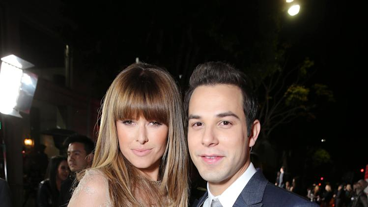 "Sarah Wright and Skylar Astin arrive at the LA premiere of ""21 and Over"" at the Westwood Village Theatre on Thursday, Feb. 21, 2013 in Los Angeles. (Photo by Eric Charbonneau/Invision/AP)"