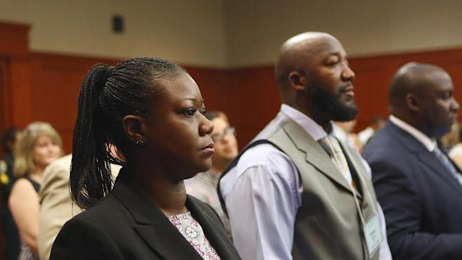 Trayvon Martin's parents, Sybrina Fulton, left, and Tracy Martin, center, attend George Zimmerman's trial in Seminole circuit court in Sanford, Fla. on Thursday, June 27, 2013. Zimmerman has been charged with second-degree murder for the 2012 shooting death of Trayvon Martin. (Jacob Langston/Orlando Sentinel)