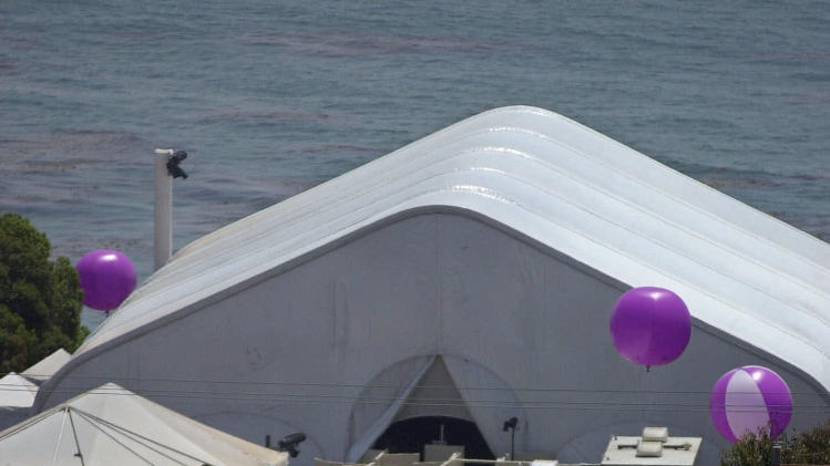 FILE - In this July 29, 2000 file photo, security and caterers set up for the oceanside wedding of Brad Pitt and Jennifer Aniston in Malibu, Calif. In contrast to Brangelina's smallish, tight-as-a-drum ceremony, Pitt's last wedding to Aniston was huge and over the top. The $1 million ceremony in 2000 included a 40-piece gospel choir, floating lotus flowers, a 13-minute fireworks display and imported candles from Thailand. (AP Photo/Mark J. Terrill, file)
