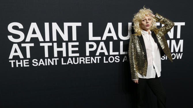 Lady Gaga poses as she arrives for the Saint Laurent fall collection fashion show at the Hollywood Palladium in Los Angeles