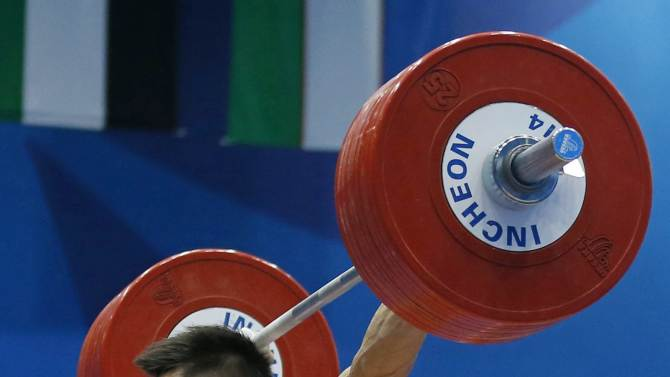 Lyu sets a new record during the men's 77kg snatch weightlifting competition at the 17th Asian Games in Incheon
