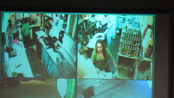 During a news conference, police show surveillance video of  Samantha Koenig, 18, making a cup of Americano coffee for a customer who shortly after abducted her Feb. 1, 2012, in Anchorage, Alaska. Police on Tuesday, Dec. 4, 2012, released the surveillance camera footage from the February abduction at the Common Grounds expresso stand in Anchorage. The release came two days after her confessed killer, Israel Keyes, was found dead in his Anchorage jail cell, apparently by suicide. (AP Photo/Mark Thiessen)