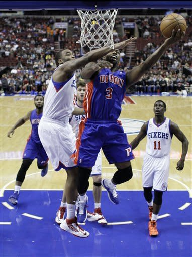 Holiday leads 76ers past Pistons 104-97