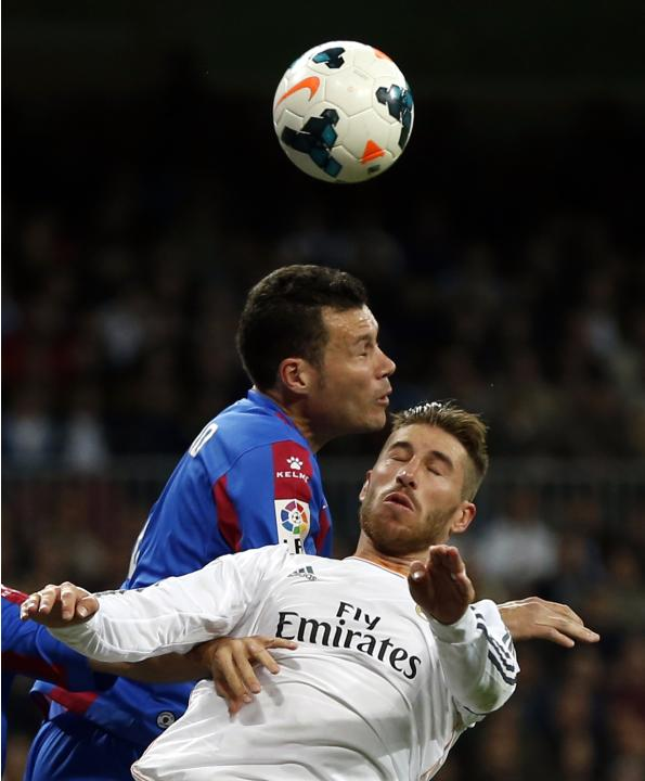Real Madrid's Ramos and Levante's Navarro fight for the ball during their Spanish first division soccer match in Madrid