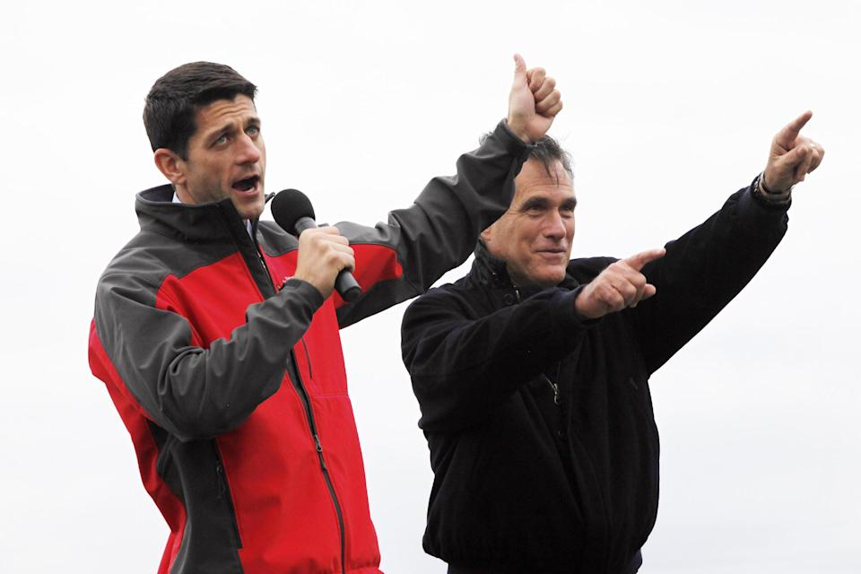 Republican presidential candidate and former Massachusetts Gov. Mitt Romney and vice presidential candidate Rep. Paul Ryan, R-Wis., campaign at the Celina Fieldhouse in Celina, Ohio, Ohio, Sunday, Oct. 28, 2012. (AP Photo/Charles Dharapak)