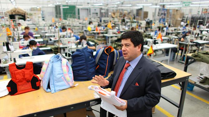 Miguel Caballero, owner of  the Colombian company of the same name that makes stylish bulletproof clothing, speaks during an interview, at his factory on the outskirts of Bogota, Colombia, Thursday, Jan. 3, 2013. Caballero who has made armored vests for adults for more than 20 years, said he had never thought about making bulletproof goods for children. But that changed after the Dec. 14 slaying of 20 small children and six adults at the Sandy Hook Elementary in Newtown, Connecticut. His new line of products are designed for children ranging in age from 8-16 years and are priced at anywhere from $150-$600 depending on the complexity of their construction. Each piece weighs between 2-4 pounds. (AP Photo/William Fernando Martinez)