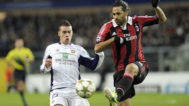 Anderlecht's Massimo Bruno (L) fights for the ball with AC Milan's Mario Yepes during their Champions League Group C soccer match at the Constant Vanden Stock stadium in Brussels