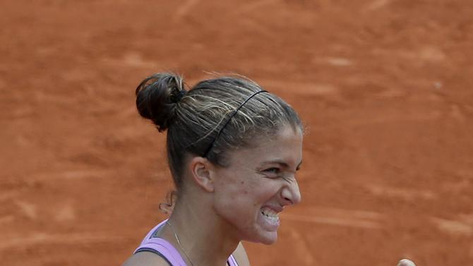 Italy's Sara Errani celebrates winning the third round match of the French Open tennis tournament against Germany's Andrea Petkovic in two sets 6-3, 6-3, at the Roland Garros stadium, in Paris, France, Saturday, May 30, 2015. (AP Photo/Michel Euler)