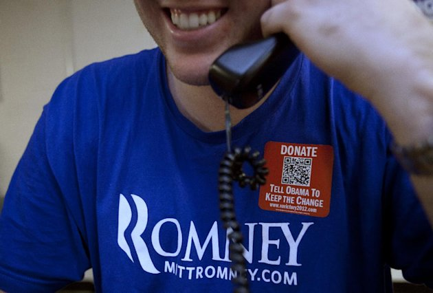 Bryan Munks, 19, of Arlington, Va., makes calls for the Romney campaign while wearing a quick response code sticker, or QR, in Fairfax, Va., on Tuesday, June 19, 2012.   The presidential ground game h