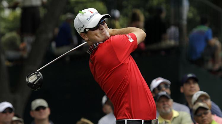 Zach Johnson watches his tee shot on the third hole during the third round of the PGA Colonial golf tournament, Saturday, May 26, 2012, in Fort Worth, Texas. (AP Photo/LM Otero)