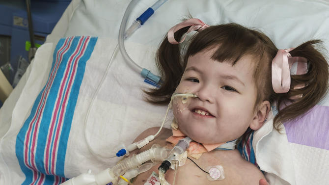 FILE - In this April 26, 2013 file photo provided by OSF Saint Francis Medical Center in Peoria, Ill., Hannah Warren, 2, lies in bed in a post-op room at the Children's Hospital of Illinois in Peoria, after having received a new windpipe in a landmark transplant operation on April 9, 2013. Hannah, who was born in South Korea without a windpipe received a new one made from her own stem cells, died Saturday, July 6, 2013. She was the youngest patient in the world to benefit from the experimental treatment. (AP Photo/OSF Saint Francis Medical Center, Jim Carlson, File)