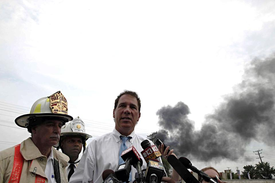 Baltimore County Executive Kevin Kamentz stands with Baltimore County Fire Chief John J. Hohman, left, and Assistant Fire Chief Jeffrey Segal as he speaks to reporters about the White Marsh train derailment in Rosedale, Md., Tuesday, May 28, 2013. (AP Photo/Charles Dharapak)