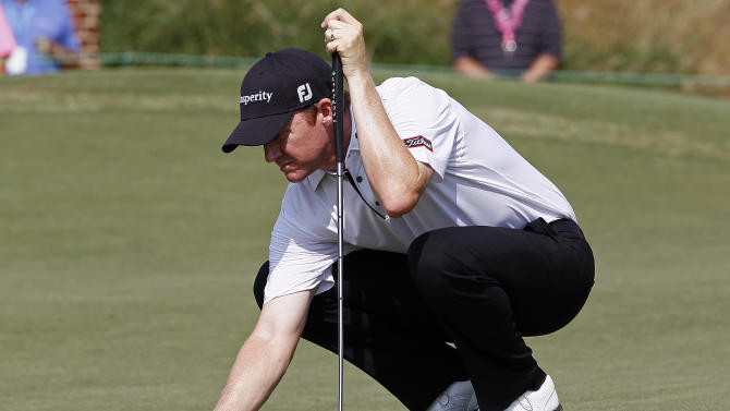 Jimmy Walker lines up a putt on the ninth green during the second round of the Wyndham Championship golf tournament in Greensboro, N.C., Friday, Aug. 17, 2012. (AP Photo/Gerry Broome)