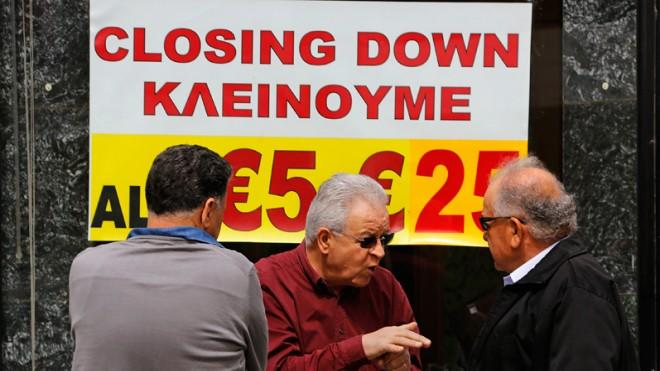 Cypriot shop owners chat about the disturbing financial state of their island nation on March 22.