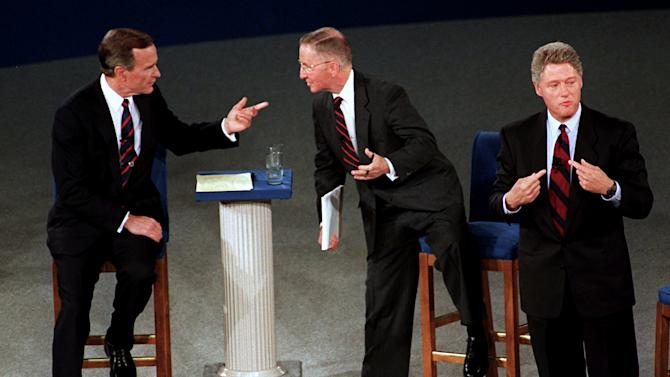 FILE - In this Oct. 15, 1992 file photo, President Bush, left, talks with independent candidate Ross Perot as Democratic candidate Bill Clinton stands aside at the end of their second presidential debate in Richmond, Va.  Finally, the fall season delivers the matchup Americans have been waiting for, President Barack Obama goes one-on-one with Republican Mitt Romney in three prime-time debates. With the race a dead heat, the debates take on an oversized role in the few weeks between now and Election Day. One small mistake or impression _ a glance at a watch, repetitive sighing _ could roil the campaign for days and linger in voters' mind. This is especially true for two polished candidates who will have the soundbites and rhetoric down cool.  (AP Photo/Marcy Nighswander, File)