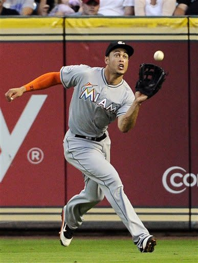 Marlins beat Astros 5-3 in 12 innings
