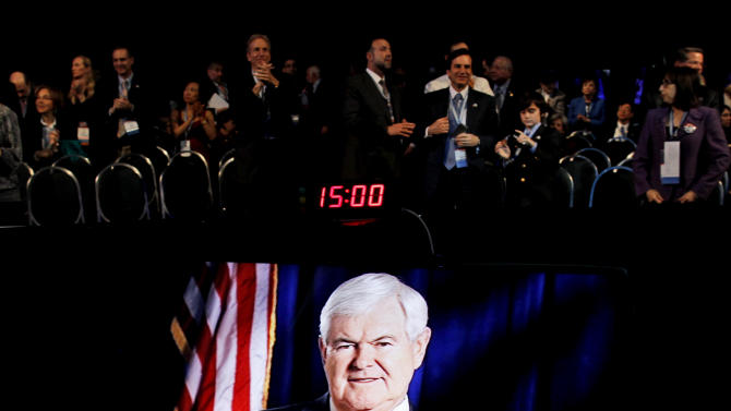 Republican presidential candidate, former House Speaker Newt Gingrich, appearing via satellite, speaks before the American Israel Public Affairs Committee (AIPAC), in Washington, Tuesday, March 6, 2012. (AP Photo/Charles Dharapak)