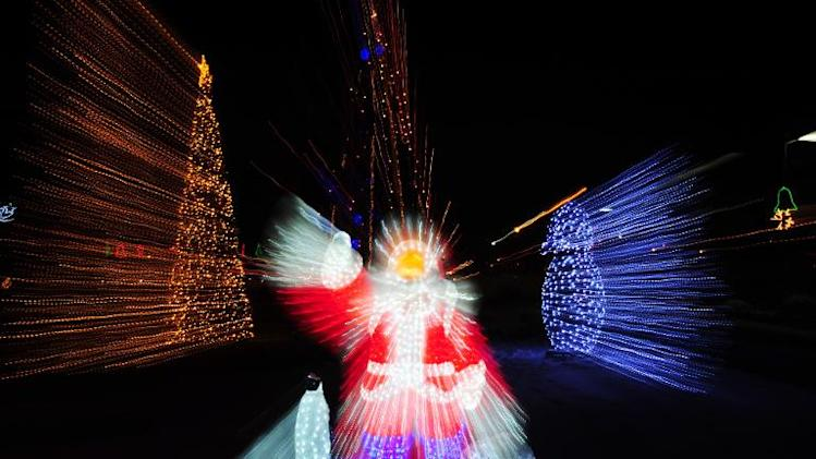 A picture taken with a zoom effect shows Christmas light decorations at a Park in Bucharest on December 17, 2010