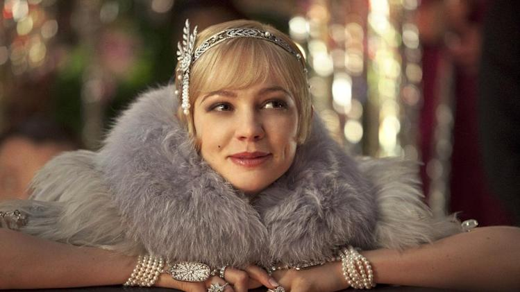 """This film publicity image released by Warner Bros. Pictures shows Carey Mulligan as Daisy Buchanan in a scene from """"The Great Gatsby."""" (AP Photo/Warner Bros. Pictures, Matt Hart)"""