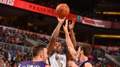 Johnson lifts Nets to 100-98 OT win over Suns