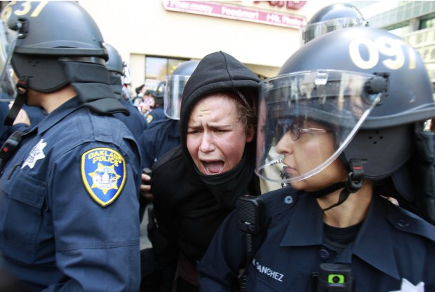 An Occupy demonstrator clashes with Oakland police during May Day protests in Oakland