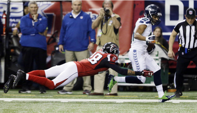 Seattle Seahawks wide receiver Golden Tate (81) gets past Atlanta Falcons free safety Thomas DeCoud (28) for a touchdown reception during the second half of an NFC divisional playoff NFL football game