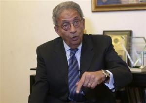 Former foreign minister and presidential candidate Moussa speaks during an interview in Cairo