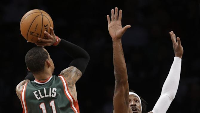 Milwaukee Bucks guard Monta Ellis (11) shoots over Brooklyn Nets forward Gerald Wallace (45) in the first half of their NBA basketball game at Barclays Center, Tuesday, Feb. 19, 2013, in New York. (AP Photo/Kathy Willens)