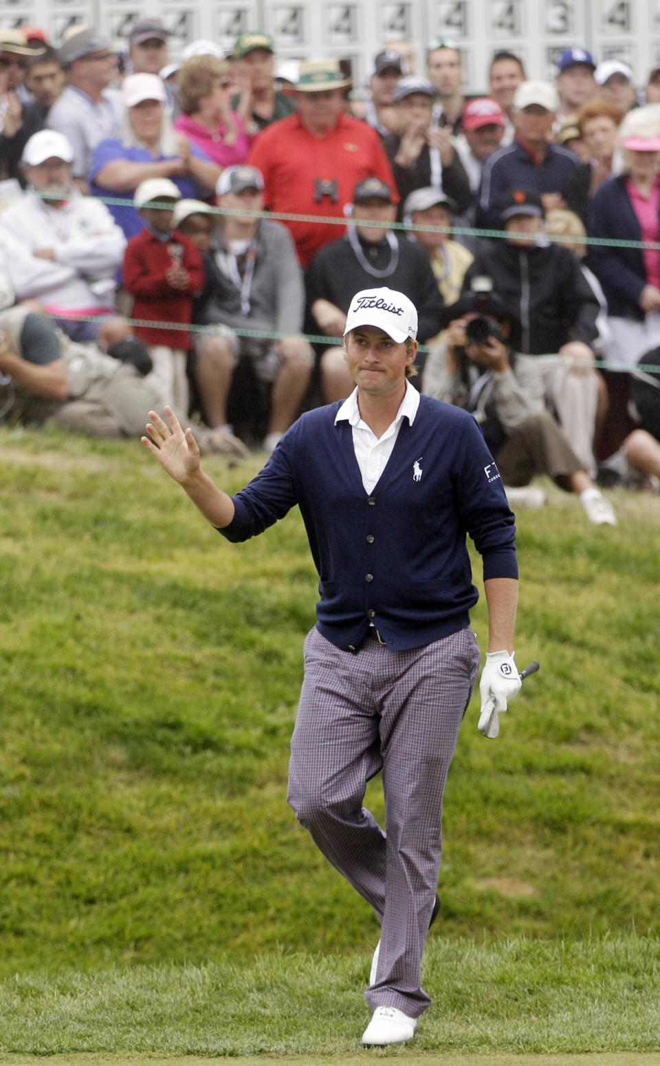 Webb Simpson waves after chipping on the 18th hole during the fourth round of the U.S. Open Championship golf tournament Sunday, June 17, 2012, at The Olympic Club in San Francisco. (AP Photo/Ben Margot)