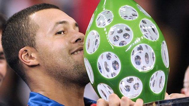 rance's Jo-Wilfried Tsonga holds his trophy after defeating his Italian opponent Andreas Seppi