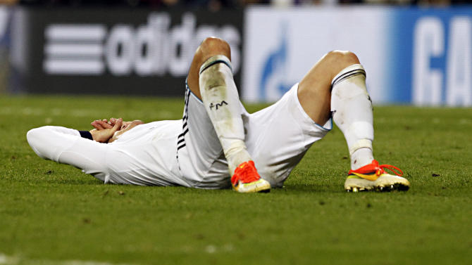 Madrid's Cristiano Ronaldo from Portugal lies on the pitch during the Champions League semifinal second leg soccer match between Real Madrid and Borussia Dortmund at the Santiago Bernabeu stadium in Madrid, Spain, Tuesday April 30, 2013. (AP Photo/Alberto Di Lolli)