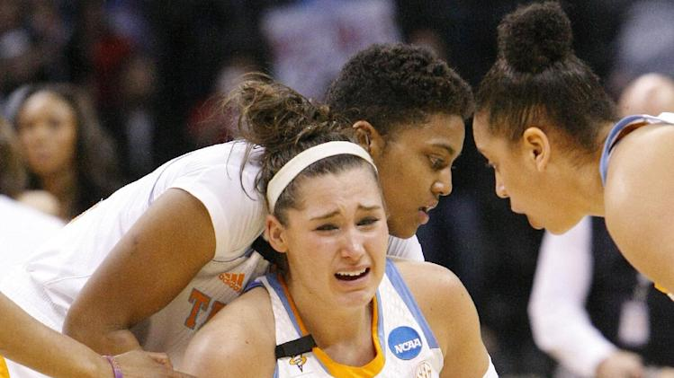 Tennesse's Taber Spani, front, and Kamiko Williams, back, react to loosing to Louisville in the Oklahoma City regional final game in the women's NCAA college basketball tournament in Oklahoma City, Tuesday, April 2, 2013.   Louisville own 86-78.  (AP Photo/Alonzo Adams)