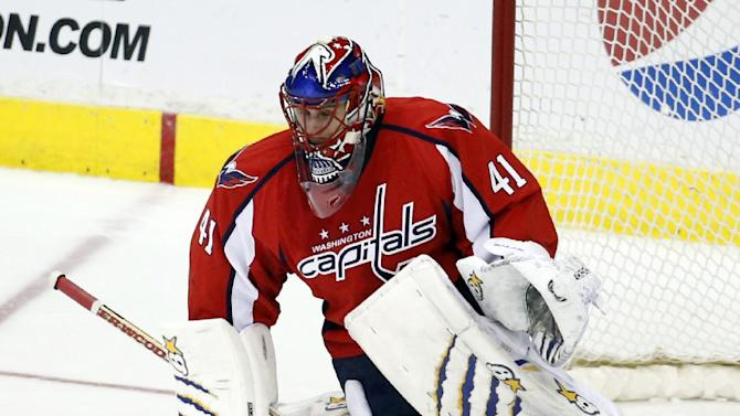 Washington Capitals goalie Jaroslav Halak, from the Czech Republic, can't stop the goal by Los Angeles Kings center Jeff Carter in the shootout portion of an NHL hockey game, Tuesday, March 25, 2014, in Washington. The Kings won 5-4 in a shootout