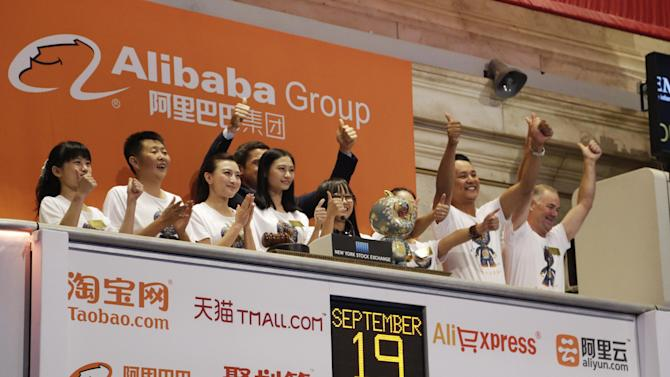 Alibaba employees attend the opening bell ceremony during the company's IPO at the New York Stock Exchange, Friday, Sept. 19, 2014 in New York. (AP Photo/Mark Lennihan)