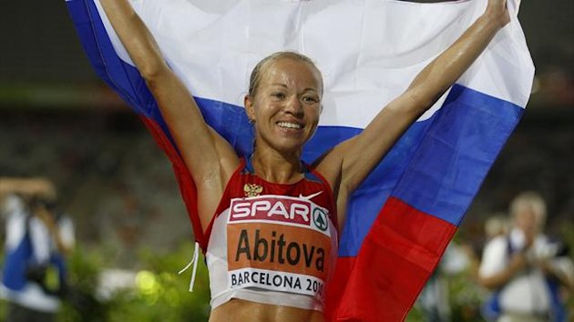 Inga Abitova of Russia celebrates after winning the silver medal in the women's 10,000 metres final at the European Athletics Championships in Barcelona